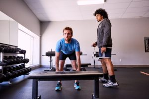 personal trainer sese ianu coaching dumbbell workouts at slc strength and conditioning gym